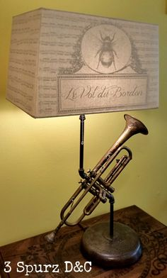 Vintage trumpet that will be making any music room light up.       A custom shade is the bee's buzz on this lamp set up. Follow us for more wonderful pins at http://pinterest.com/3spurzdandc/ http://facebook.com/ http://www.3spurzdesignsandcollectables.com/home 3 Spurz D&C Repurposed /Refurbished Creations!!