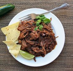 Tender and juicy, easy crock pot shredded beef. This barbacoa recipe can be used in everything from tacos to burrito bowls!