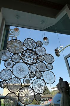 Installation made of lace crochet mandalas.