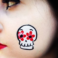 Face painting: Looks like Dia de los Muertos