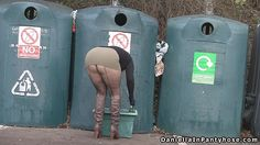 Public pantyhose upskirt sexy big bottom woman in arse revealing skirt, fishnet tights with seams and leather boots bends over exposing her seamed fishnet ass outdoors at recycling center.