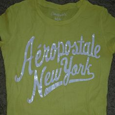 Yellow Aeropostale T-shirt Yellow with white writing aeropostale t-shirt! Only been wore a few times! In very good condition! If you have any questions, just leave them in the comments! Aeropostale Tops Tees - Short Sleeve
