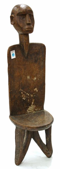 African carved wood male figural chair