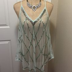 NWT Mint Sequin Sheer Tank Brand new with tag. Size medium. Has small hole near the label, and what looks like a little spot. Only flaw, otherwise in excellent condition. Rue 21 Tops Tank Tops
