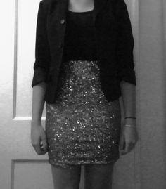 Gold sequin skirt, plain black T, black blazer, nude heels, messy sock bun, Ray-Ban Wayfayer optics, cat eyeliner, & red lipstick.