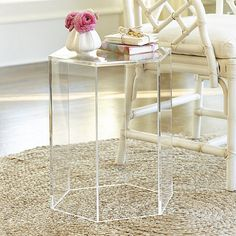 A touch of acrylic can lend light, fresh energy to any room. Our Acrylic Hexagon Side Table is crafted of thick-walled, high-quality acrylic. Use one beside a chair a bunch several together to create a unique coffee table. Acrylic Hexagon Side Table features: Open bottom lets you place art, books or decorative objects underneathFully Assembled