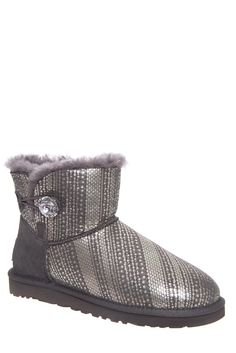 UGG Australia Women's Mini Bailey Button Bling (6 M US Women's, Grey). Mini boot height of 5 inches. Genuine Swarovski crystal on button. Fully lined with 17mm of UGGpure. Molded EVA outsole. Metallic design printed on upper.