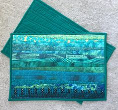 Pieced teal place mats. Handmade. 13x19 in. Quilted table