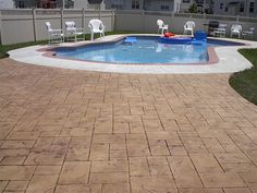 Stamped Concrete Pool Deck... Too Dark For Me, But Good To Know