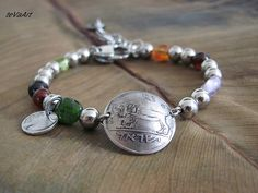 Regylar Price $36.17       SALE 10% 0ff  Current Price $32.55   Vintage Coin bracelet made in the author's style for men and women with stainless steel, brown-orange agate,...