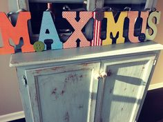 Wood letters, paint, scrapbook paper, spray adhesive, mod podge edges and back of letter, ribbon!
