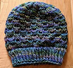 I have been spending time in the Pacific Northwest recently, and am in love with the brickwork on the buildings. This simple knit/purl pattern creates the texture that reminds me of the architecture in the PNW. This hat has a simple 6 stitch and 8 row repeat that is designed to keep it interesting, while being easy to memorize. This hat can be adjusted to fit any size head or knit gauge by casting on multiples of 6. If you want a shorter or taller hat, you can simply increase or decreas...