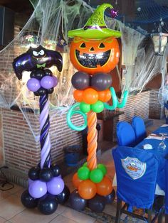Halloween balloon columns: crazy pumpkin and naughty bat... quite the pair!