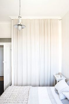 out the closet doors and use a curtain rod to hang two white curtains ...