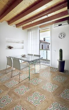 Natucer Plume series from Tile of Spain adds a touch of color and pattern to this #tile kitchen floor.