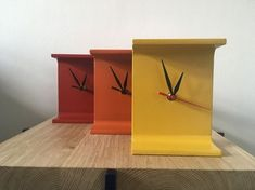 Clocks made from recycled metal I Beam (used in construction) sprayed in enamel paints, red, yellow and orange. Fitted with a quartz Clock mechanism. Size: 150 mm H x 120 mm W x 90 mm D Please message with colour preference Please message before buyin. Make A Clock, Diy Clock, Clock Ideas, Wall Clock Wooden, Metal Clock, Clock Wall, Metal Sheet Design, Chair Design Wooden, Metal Art Projects