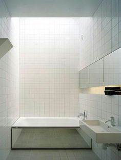 infinity under the bath!!! Bathroom white tiles and mirror bath surround Minimalist Decor, Minimalist Fashion, Minimalist Style, Minimal Bathroom, White Tiles, Skylight, Bathrooms, Bathroom Styling, Modern Decor