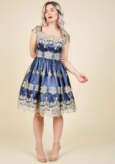 Fanciful Finesse Fit and Flare Dress | Mod Retro Vintage Dresses | ModCloth.com  Flaunting this aegean blue dress, you enter the gala to a chorus of compliments. Veiled with a black mesh overlay - embroidered with intricate silver florals and adorned by gold metallic threads - this satiny gown will be the most delicate and delightful ensemble seen at the party!