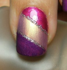 Cute and simple...but can I do it...lol Purple and pink nail polish with glitter stripes to break up the colors!