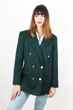 Chaqueta vintage de pura lana. 80's. Solapa ejecutiva y con dos bolsillos. Hecha en Gran Bretaña. Botones marineros dorados. Talla M-L.