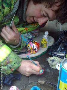 Ben Wilson, an English outside artist who paints on chewing gum stuck to the street