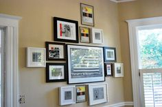 Greener Grass: Greener Grass Dining Room Tour.  Wall photo frame collage and useful tip about using paper cut to same size as frames to help yourself visually arrange frames before hanging them...
