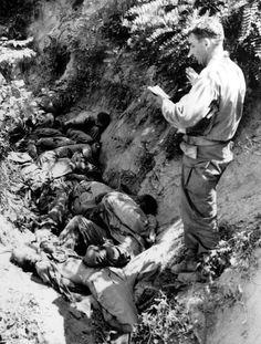 Korean War Army Chaplin prays over executed American soldiers, Korea, 08-22-50. Courtesy Everett/CSU Archives