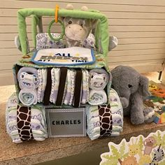 Blue four wheeler, diaper cake, bike baby, baby shower gift, baby shower centerpiece Baby Shower Menta, Baby Shower Camo, Baby Shower Gifts, Eeyore, Piglet, Jeep Diaper Cake, Diaper Bike, Diaper Centerpiece, Unique Baby Boy Gifts
