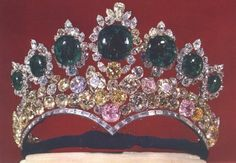 The tiara was designed by Harry Winston,on the marriage of Reza Shah Pahlevi in 1958. It was considered to be Farah's favorite tiara. The brilliant-cut diamonds were probably re-cut in the 19th century from loose Indian diamonds which were in the treasury. The emeralds are probably from South America, though they were cut sometime before Nader Shah's campaign in India. The diamonds surrounding the emeralds are probably from South Africa.