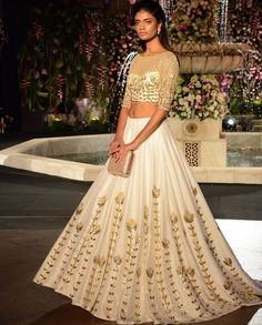 A white and gold ensemble to shine bright on your sister's wedding.