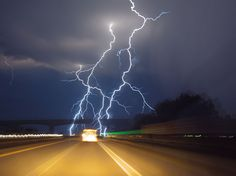 Storm Chasing    Photograph by Carsten Peter, National Geographic