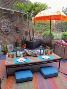 great boho chic patio or deck ideas. Love the colors and foliage.