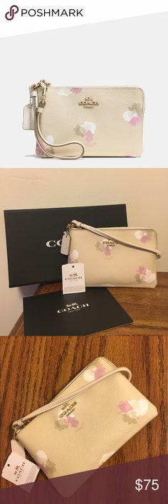 """NWT Coach stunning floral wristlet!! NWT Coach stunning floral wristlet!! Measures 6.5"""" in length & 4"""" in height- price tag is included with this purchase, but not attached to the purse Coach Bags"""
