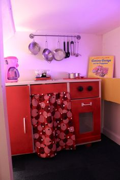 awesome under the stairs kitchen made by flipping a billy bookcase on its side! (also check out the rest of the cute firestation!)