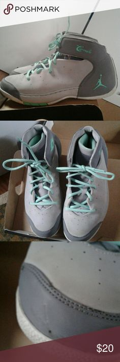 Jordan Carmelo basketball sneakers Grey and turquoise Jordans. Barely worn only noticible scratch in picture 3 and logo faded. Size 7 youth-non smoking. Jordan Shoes Sneakers
