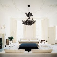 Loving the detailing on the ceiling.  Instead of a small medallion around the chandelier, its an oval spread out on the ceiling instead.  Love it.