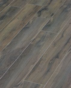 Porcelain Wood Tile.  I saw this on Property Brothers - it was in a bathroom and laid at an angle.