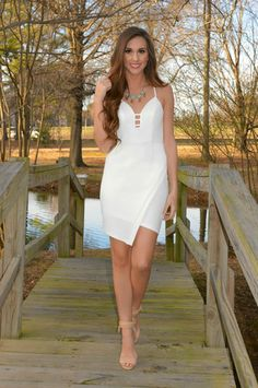 "The Sleeveless white dress with sweetheart cut neckline {with lattice cut-outs}, crossover asymmetrical bottom hem & gorgeous open ""racerback-style"" back with crochet laced accents is perfect for all brides to be! Whether it's for your rehearsal dinner, bachelorette party, or wedding shower it's a must-have!"