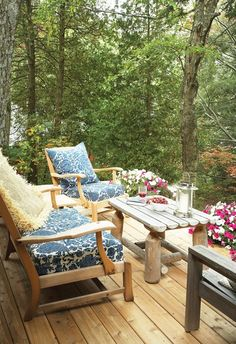 Classic Cottage Porch  Warm cedar furniture, patterned cushions and bright flowers invite guests to linger.