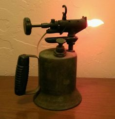 Lamp made from a vintage gas torch.