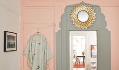 Spruce Up a Blah Doorway with a Chic, Morocco-Inspired Paint Job -- With scissors, kraft paper, brushes, one color of paint, and a single afternoon, you can DIY a gorgeous renovation of any doorway with Moroccan bohemian style for a statement-making entrance every time!