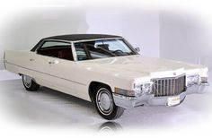 1970 Cadillac Sedan DeVille. My dad drove a blue green one just like this.