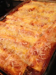 Enchiladas 1 lb beef (browned) 1 can kidney beans 1 can corn 1 small can green chilies salt pepper 1/4 t cumin 1/4 t chili powder 1/2 c salsa 2 cans enchilada sauce (mild or med) 1 can cheddar cheese soup  10 flour tortillas 2 c cheddar