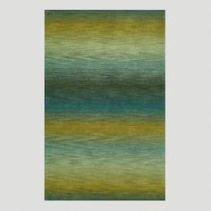 One of my favorite discoveries at WorldMarket.com: Ombre Stripes Ocean Wool Rug This would go great with a tan couch and deep blue wall!