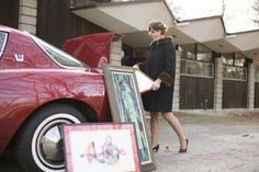 Bobbie in front of her mid century modern home, unloading some new finds from the trunk of a 1958 Avanti!  www.athomemodern.com