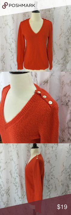 Orange wool J. Crew button shoulder sweater J. Crew orange wool blend v-neck sweater with buttons on the shoulders. Lightweight but warm. Slight pilling. Size Medium. Approximately 20 inches armpit to armpit, 24.5 inches long. Shown with Maeve skirt also for sale in closet. Bundle and save.   Offers welcome. Thanks for shopping my closet! J. Crew Sweaters V-Necks