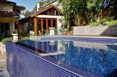 This stylish above ground plunge pool is the highlight of a beautiful Balinese-styled yard. Fully lined with deep-blue glass mosaic tiles with a wet-edge...