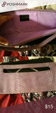 Beautiful lavender snake print clutch Lavender snake print long clutch. Great condition! Bags Clutches & Wristlets