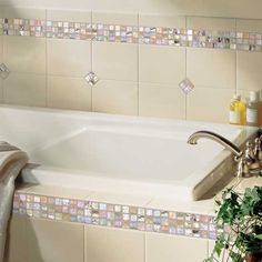 Details: Photo features Almond 6 x 8 field tile with City Lights in Hollywood 1/2 x 1/2 mosaic on wall and tub surround.