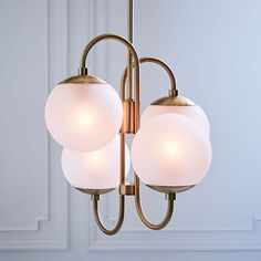 """Pelle Asymmetrical Chandelier - 4-Light   west elm $499 : 20""""diam. x 20""""h. Base dimensions: 20""""diam. x 20""""h. Canopy dimensions: 5""""diam. Length from lamp to ceiling adjusts incrementally from 26"""" to 62"""" (includes three 12"""" rods and one 6"""" rod). Accommodates four 13W CFL bulbs or four 60W incandescent bulbs."""